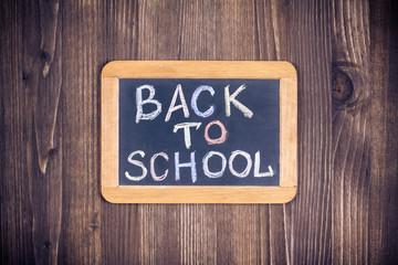 Back to school blackboard banner on wood wall background