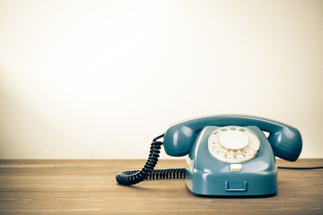 Retro background with rotary telephone on wood table