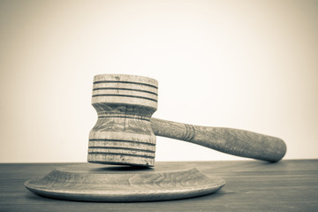 Vintage background with old judge gavel on table