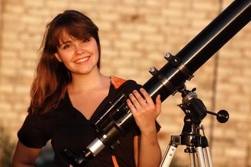 Teen girl and telescope.Near Kiev,Ukraine