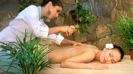Woman getting massage at spa.