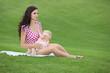 woman breastfeeding her baby outdoors