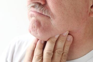 closeup of man with sore throat