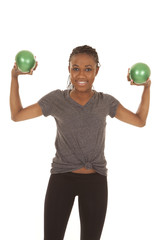woman in gray shirt fitness green balls up