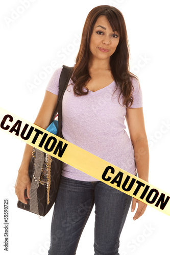 woman shopper caution tape