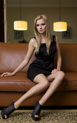 blond woman in black dress