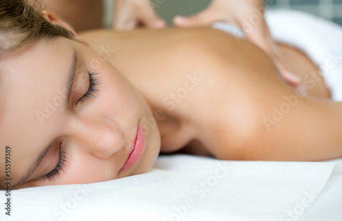 canvas print picture Relaxed woman receiving a massage in a spa
