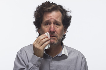 Man with cold or allergies, horizontal