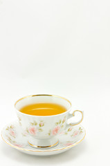 porcelain tea cup full of tea  on a white background