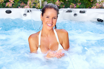 Beautiful woman in jacuzzi.