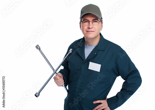 Auto mechanic with a wheel wrench.