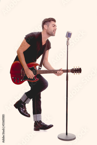 rock star singing with guitar