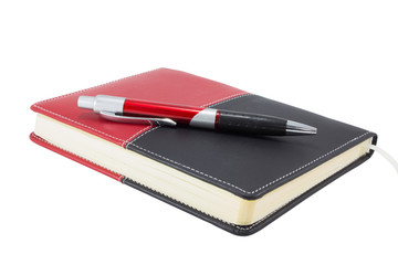 Pocket diary and ballpen isolated on white background