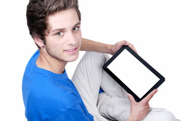 teenage boy holding a tablet