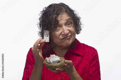 Unhappy woman with her nest egg, horizontal