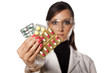 woman laboratory worker showing a capsule pills