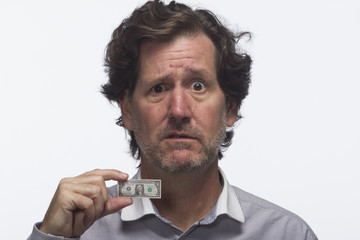 Disappointed man with dollar bill, horizontal