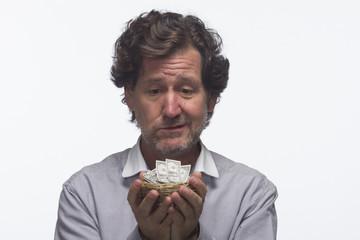 Sad man with this nest egg (money), horizontal