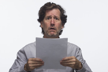 Business man holding report looking overwhelmed, horizontal