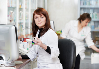 Two Pharmacy chemist women in drugstore