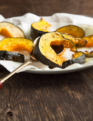 Baked pumpkin slices with herbs and olive oil