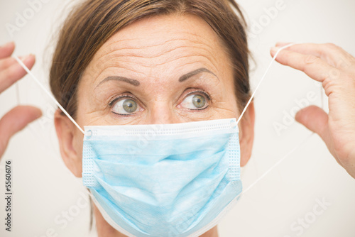 Female nurse or doctor with mask over face