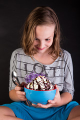 Young girl eating an ice cream sundae