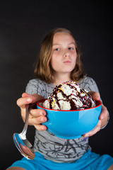 Young girl sharing a bowl of ice cream