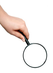 Magnifying glass in hand.