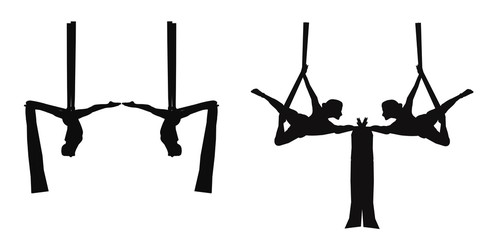 duo aerial silk dancers in silhouette