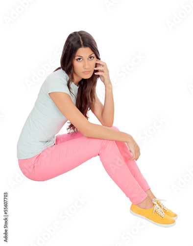 Casual girl sitting on the floor