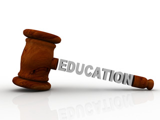 Wooden gavel with education. LAW concept