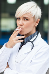 Female doctor is smoking