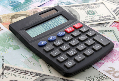 calculating cash: calculator on banknotes