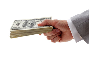 hand of businessman holding pile of dollars