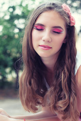 beautiful young girl with long hair and makeup for a walk