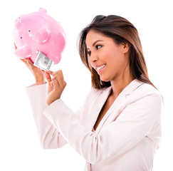 Woman taking money from a piggybank