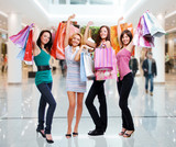 Women with shopping bags at shop