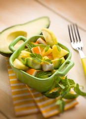 salad with avocado surimi and pineapple, selective focus