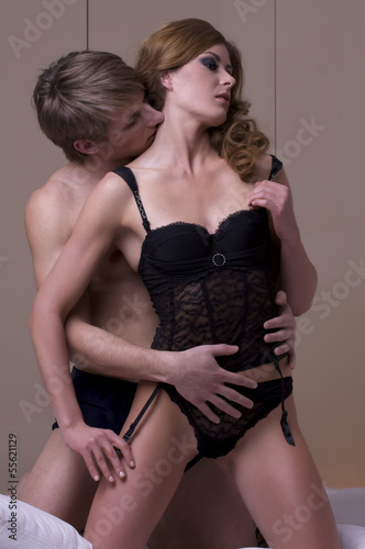intimate young couple during foreplay