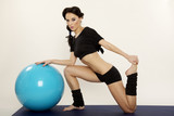 Woman with fitness ball - 55621562