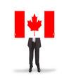 Smiling businessman holding a big card, flag of Canada
