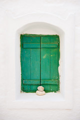 Green window on white wall