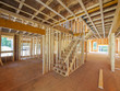Interior framing of a new house under construction - 55623389