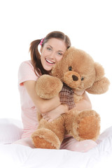 Teenager with teddy bear. Beautiful young woman sitting on the s