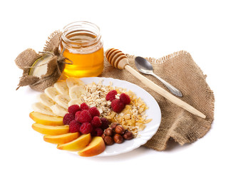 still life with honey, fruits nuts and flakes