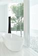 Modern white bathtub against huge windows