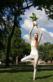 woman standing in tree pose