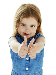 Cute little girl shows both thumbs up