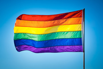 Rainbow Gay Pride Flag on blue sky background, Miami Beach, Flor